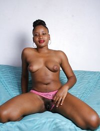 Black solo girl with natural boobs exposes the pink of her vagina